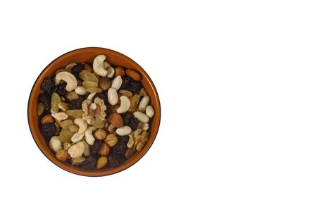 Mixture of nuts and dried fruits on an isolated white background. top view. 写真素材
