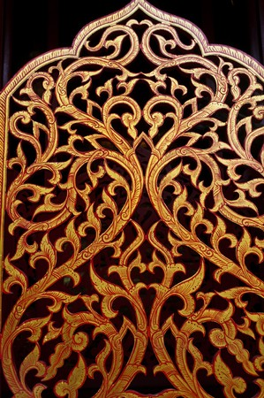 traditional thai style wood carving photo