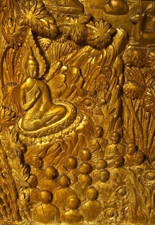Buddha carved gold paint on church door photo