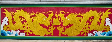 colorful chinese dragon at the wall of temple, Thailand photo