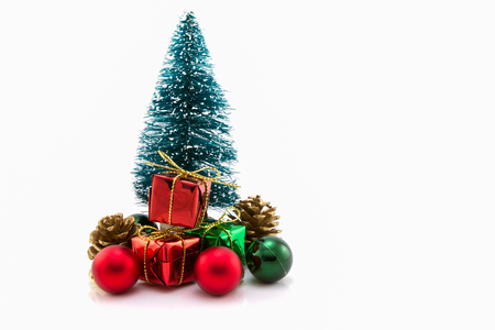 Christmas tree with gifts on white background.