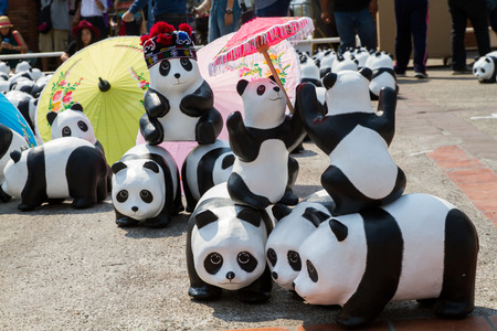wwf: CHIANG MAI, Thailand - March 19, 2016 : 1600 Pandas World Tour in Thailand by WWF at Tha-Pae Gate . 1600 paper marche pandas are made from recycled materials to represent 1600 pandas left in the wild