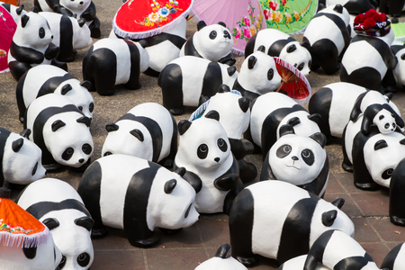 represent: CHIANG MAI, Thailand - March 19, 2016 : 1600 Pandas World Tour in Thailand by WWF at Tha-Pae Gate . 1600 paper marche pandas are made from recycled materials to represent 1600 pandas left in the wild