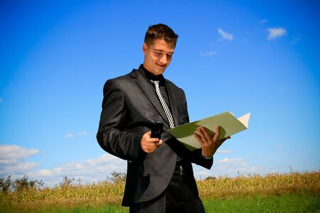 Doing business in the middle of the field Stock Photo