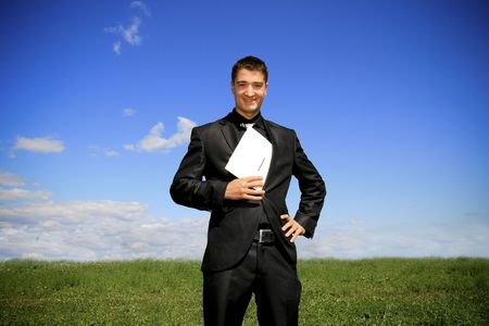 Businessman pulling a folder out his suit. Stock Photo