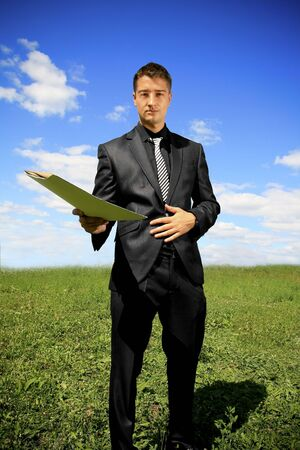 Man in black suit in the middle of the field Stock Photo