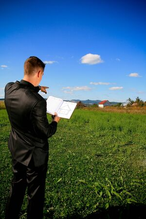 locating: Real estate agent locating a piece of land Stock Photo