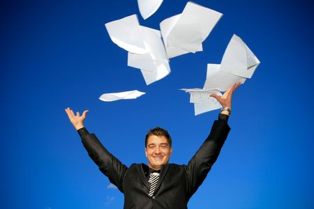 Young man throws away his documents. Standard-Bild
