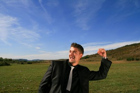 Extatic business man. Stock Photo