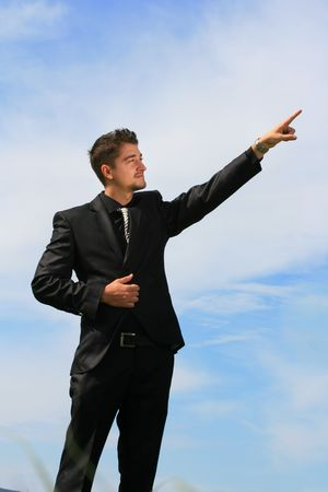 man pointing up: Business man shows ascending trend.