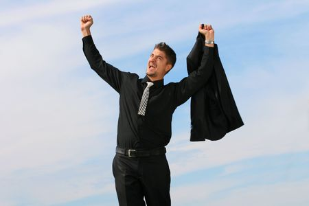 Extatic business man has his hands raised. Stock Photo