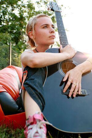 Girl holding guitar in her hands Stock Photo - 3868411