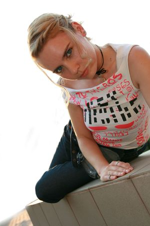 Girl sitting on the side looking at camera