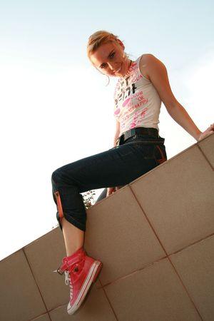 Girl sitting down looking at camera