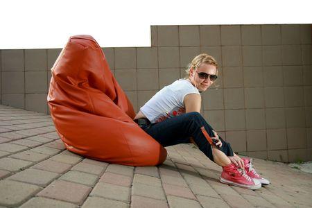 Girl looking at Camera hinsetzen Standard-Bild - 3868390