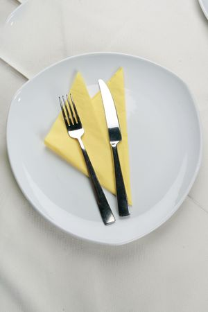 Dinner is expected on an empty plate Stock Photo