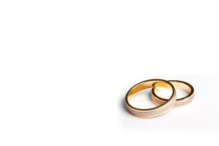 pair of wedding bands isolated on white background macro
