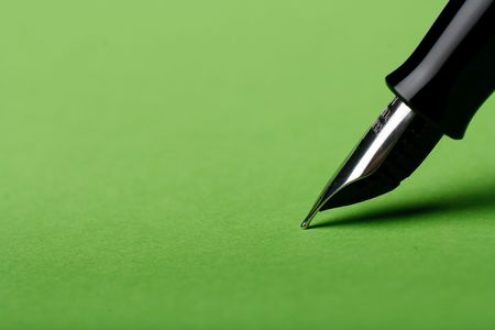 macro isolated fountain pen on green background