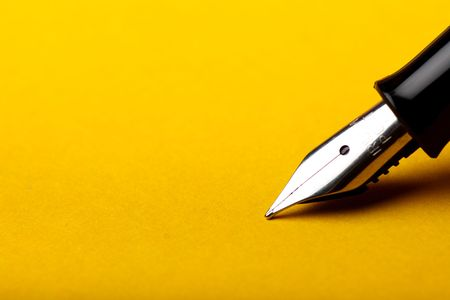 macro isolated fountain pen on amber background Stock Photo