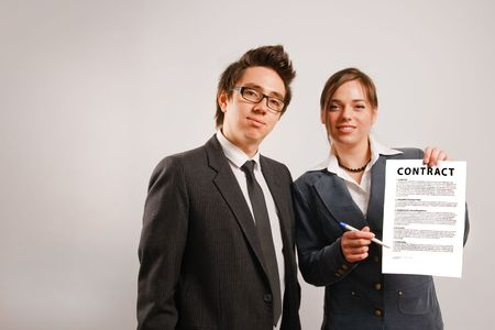 Two business partners holding a printed contract Stock Photo