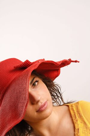 Modern looking young woman wearing a red hat photo