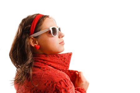 Modern looking young woman wearing a red jacket and sunglasses