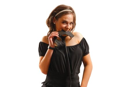 Modern looking young woman wearing a black dress and tie Stock Photo