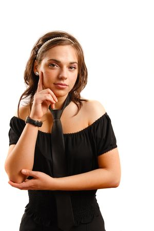Modern looking young woman wearing a black dress and tie photo