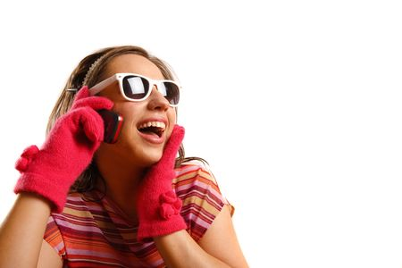 Modern looking young woman wearing sun glasses, talking on the phone
