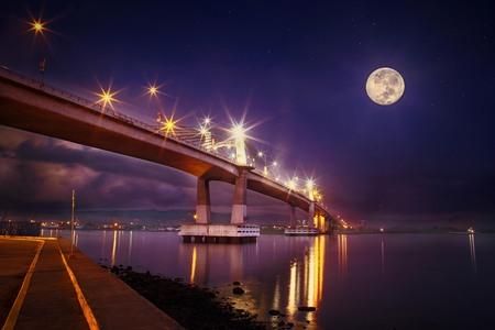 Mactan Bridge at full moon night, super moon, reflection in water, cebu mactan strait, calm sea, view point, landmark Cebu,