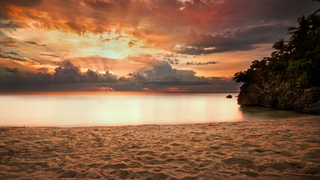sunset on beach with dramatic clouds after a thunderstorm in Cebu province Philippines