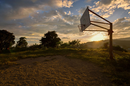 a rocky basketball field in sunset dusk a rural simple life scene