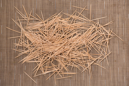 mess of bamboo toothpicks for dental care and teeth cleaning