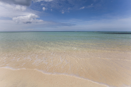 white beach with crystal clear water on a sunny day Stock fotó