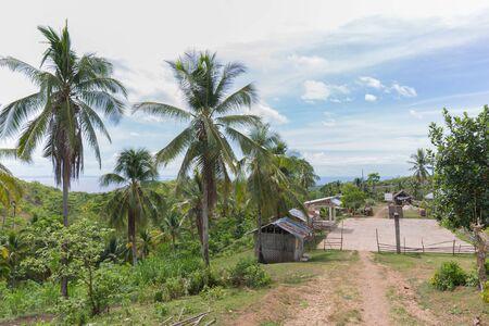 Rural Philippine basketball field in sunny daylight