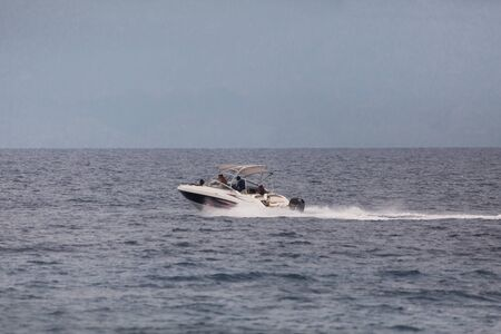 Speed boat in the open blue sea with back wash a seascape photography with copy space 版權商用圖片