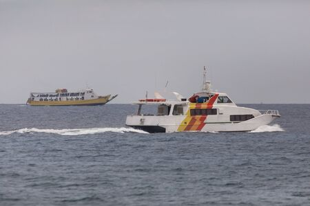 Fast ferry and speed boat in the open sea a watersport seascape photography 版權商用圖片