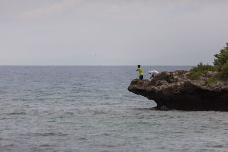 Fisherman hunting at the cliff