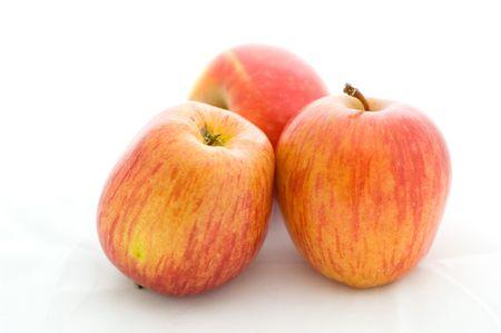three apples over white background photo