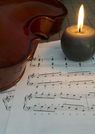 violin, candles and notes, close up