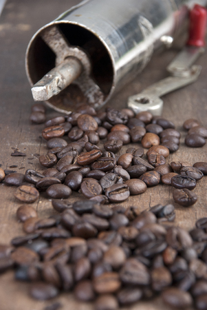 old coffee grinder and coffee , close up Stock Photo
