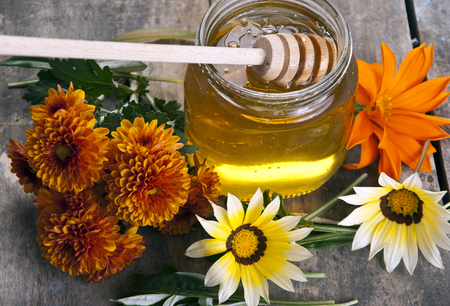 jar of honey with different flowers, close up Stock Photo