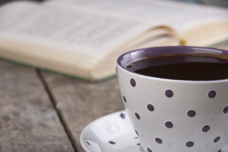 Cup of coffee on a wooden table, close up photo