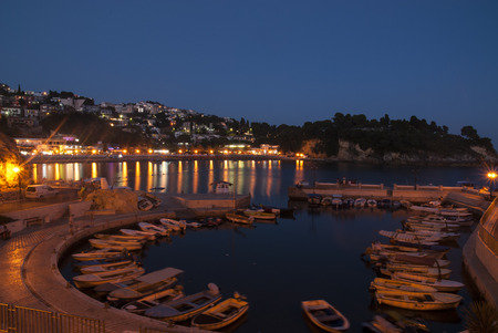 Small marina in Ulcinj by night, Montenegro, landscape photo Stock Photo