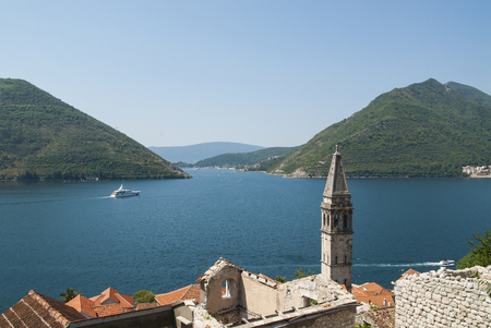 View of Boka bay in Montenegro over town of Perast, landscape photo Stock Photo