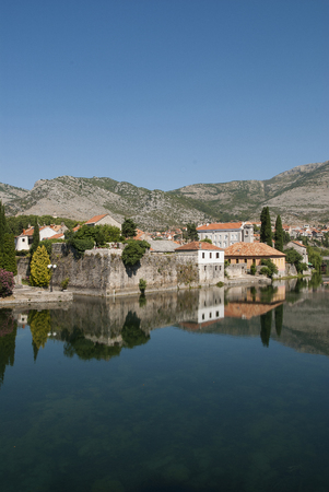 Mirror image of the old buildings in the town of Trebinje, Bosnia and Herzegovina in the water of the river, landscape photo Stock Photo