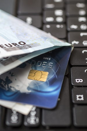 online shopping concept, credit card and money on keyboard