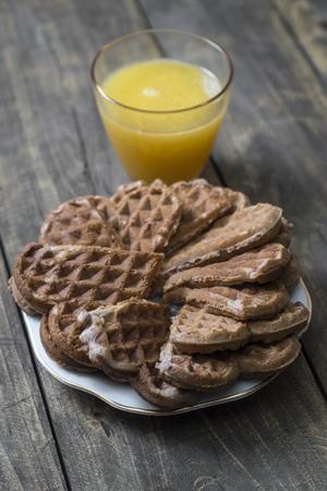 Fresh homemade heart shape waffles  and juice
