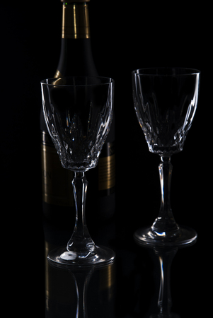 white wine glass silhouette black background, close up Stock Photo