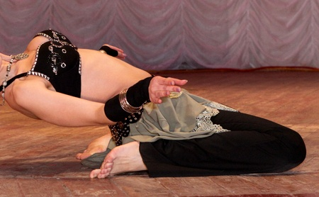 Photo of the dancing woman in the black traditional costume photo